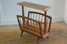 A 1950s/60s teak and walnut occasional table and two division magazine rack, with turned spindles,
