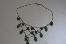 A white metal spider's web necklace mounted with jadeite pear drop and circular beads (clasp a/f)
