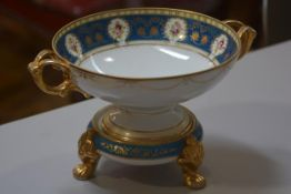 A Noritake porcelain fruit bowl on stand decorated in the French taste with blue and gilt and floral