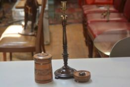 A treen carved tobacco jar and cover, a treen carved ashtray and an Edwardian mahogany turned