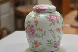 A modern Chinese porcelain ginger jar and cover decorated with crysanthemum design (h.23cm)
