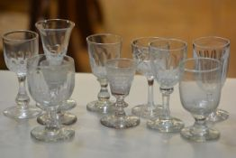 A pair of 19thc crystal tapered cordial glasses raised on domed feet, a crystal thumb cut glass,