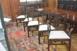 A set of six plus two Chippendale style mahogany pierced splat back dining chairs, with slip in