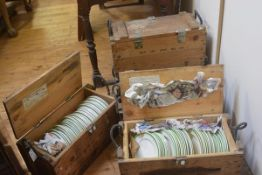 A group of five vintage wooden munitions cases containing a large quantity of hotel china. (5)