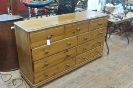 A modern pine chest of drawers, the rectangular top over three frieze drawers above two banks of