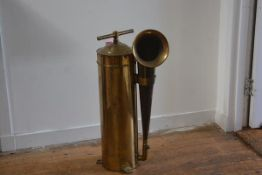 A brass marine foghorn, the domed cylindrical case with t-bar handle and side-mounted horn. 80cm