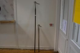 Two wrought-iron agricultural bull leading poles, each with shaped hook. Longer 169cm