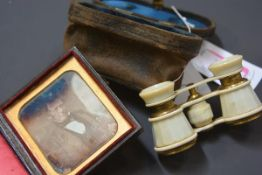 A 19th century cased daguerrotype of a gentleman in a cravat; together with a pair of cased