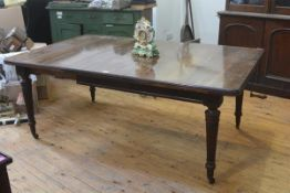 A Victorian mahogany wind-out dining table, the rectangular top with rounded corners on tapering