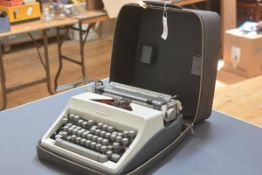 A vintage Olympia portable typewriter, cased.