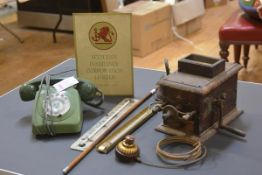 A group including a Victorian sprung service bell with brass push-button, a vintage green telephone,