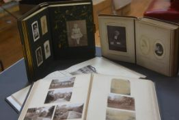 A group of four Victorian photograph albums, two with portrait photographs, one with Oxford scenes