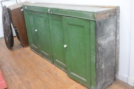 A 19th century green-painted shallow side cabinet, the rectangular top over two pairs of panelled