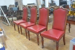 A set of four 19thc mahogany upholstered arched panel back dining chairs with studded detail, in red