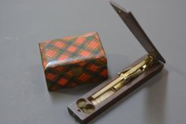 A small 19th century tartanware box; and a set of folding sovereign scales (incomplete) of similar