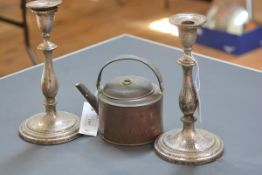 A pair of Victorian silver-plate on copper candlesticks; together with a small copper kettle.
