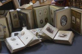 A group of eight Victorian leather-bound photograph albums, each with portrait photographs.