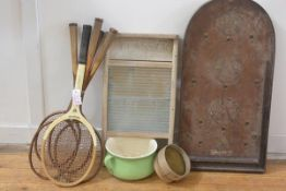 A group including a wooden tennis racket, wooden badminton rackets, vintage washboard, bagatelle