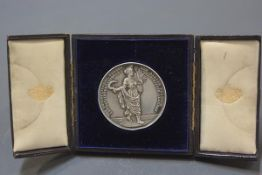 An Edwardian silver exhibition medal, The Confectioners, Bakers and Allied Trades International