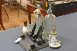 A group comprising: a Lampe Berger porcelain bottle; a 19th century French syphon inkwell with