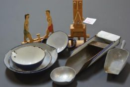 A group of toy and other enamel scoops and dishes; together with two articulated wooden toys.