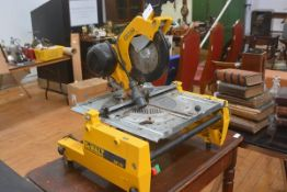 A table top circular saw, DeWalt model DW 742, with triple round pin transformer cable fitting