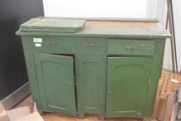 A green-painted pine country side cabinet, c. 1900, the rectangular top over three frieze drawers