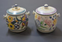 Two vintage Poole Pottery biscuit barrels and a spherical opaque glass light shade. (3) First 14cm