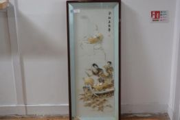 A Chinese relief panel, of shells and other materials, modelled as two figures in a boat, framed