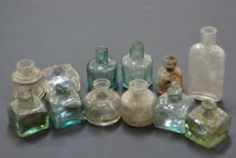 A group of 19th century coloured and clear glass ink bottles, various sizes.