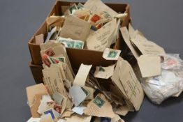 A cardboard box containing a loose stamp collection, GB and World, mostly 20th century