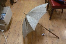 A late Victorian white-metal mounted parasol with gilt satin birch handle. 100cm