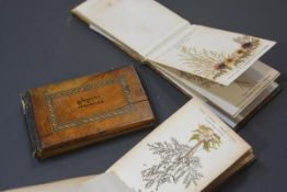 Three Jerusalem ware albums of pressed flowers, early 20th century. (3) 10cm by 17cm