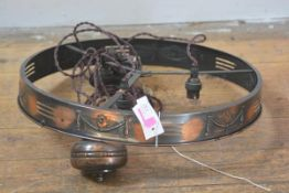 An Edwardian copper rise and fall hanging light, circular (lacking shade). Diameter 47cm
