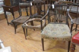 A group of three chairs: a Regency sabre leg dining chair and two Edwardian mahogany dining