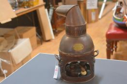 A late Victorian copper fumigator or still, with angled funnel and triple burner, bearing maker's