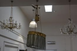 A brass three-light rise and fall ceiling lamp, with brass rose, the ring pierced and chased with