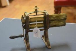 A brass table top crimping machine, second quarter 19th century, with urn finial. 25cm