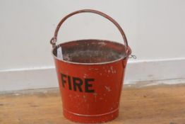 A vintage red enamel painted metal fire bucket, with swing handle. Height exc. handle 29cm