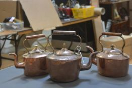 Three late 19th century copper kettles of various sizes and shapes. (3)