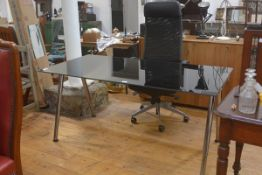 An Ikea black plate glass top adjustable desk complete with Ikea Executive style anodised metal