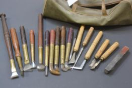 A bag containing a quantity of gilder's tools including agate and hardstone burnishers, most with