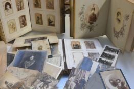Three Victorian photograph albums containing family portraits, portraits of officers, interiors,