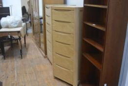 A Windsor oak upright tallboy chest of six soft closure drawers, raised on curved supports. 129cm by