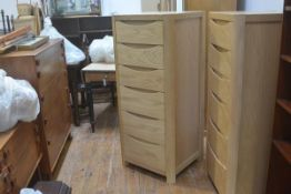 A Windsor oak upright tallboy chest of six soft-closure drawers, on curved supports. 129cm by 55cm