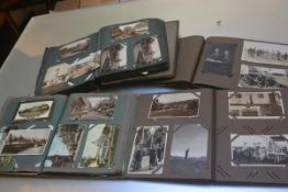 Four various photograph and postcard albums containing images of Ireland including Belfast, Dublin