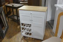 A modern Ikea kitchen freestanding prep table, with pine top above an arrangement of panel doors,