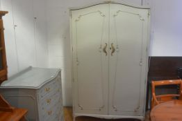 A vintage French style green painted and gilt armoire, with fitted interior. 208cm by 125cm by 63cm