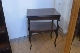 An Edwardian mahogany foldover card table, with inset leather and baize skiver and swivel top, on