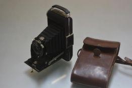 A Model D Kodak 620 Junior complete with original case etc 16cm by 30cm